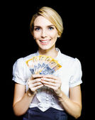 Business woman holding a cash bonanza — Stock Photo