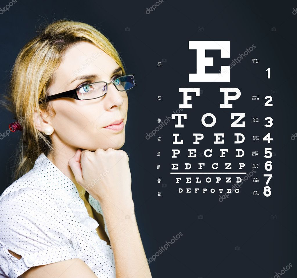 Photo Of A Beautiful Blonde Business Optician Or Optometrist Wearing Eye Wear Glasses Looking At Number And Letters On A Ophthalmology Chart To Check Eyesight — 图库照片 #10519441