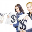 Pretty young business women holding sacks of money - Stock Photo