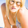 Surprised And Thought Provoked Blond WomOn Beach — Stock Photo #10588720