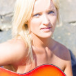 Smiling Female Guitarist - Stock Photo