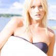 surfboarder holding surf board on sports vacation — Stock Photo