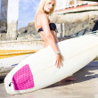Blond Surfer Babe Holding Surfboard — Stock Photo #10589018
