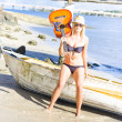 Stock Photo: Blonde Female Traveling Entertainer At Beach