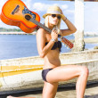 Stock Photo: Lady Performer Bowing With Guitar