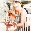 Female Traveling Guitarist Playing Music - Photo