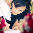 Maid Of Honour Signing Wedding Registar — Stock Photo #10589521