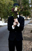 Burying Face In Funeral Flowers — Stock Photo
