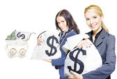 Pretty young business women holding sacks of money — Stock Photo