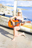 Smiling Girl Strumming Guitar At Tropical Beach — Stock Photo