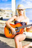 Female Beach Singer And Guitarist — Stock Photo