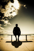 Young Man In Silhouette Sitting In The Sun — Stock Photo