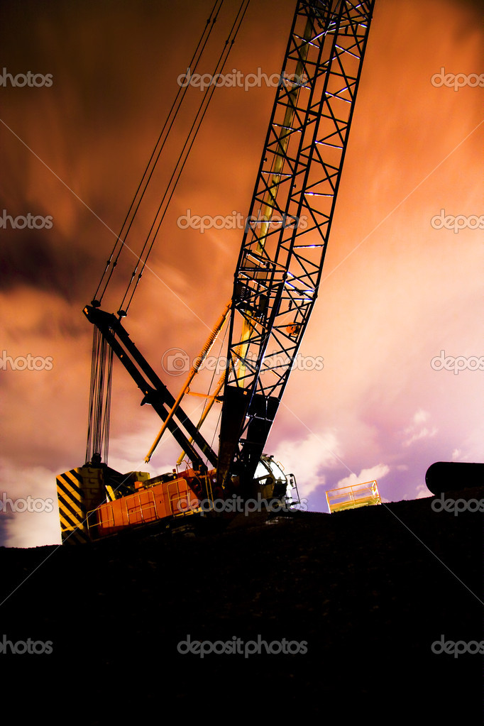 Time Lapse Photograph Taken At A 30 Second Exposure On A Construction Crane Working At Night On A Bridge Infrastructure Building Project — Stock Photo #10610099