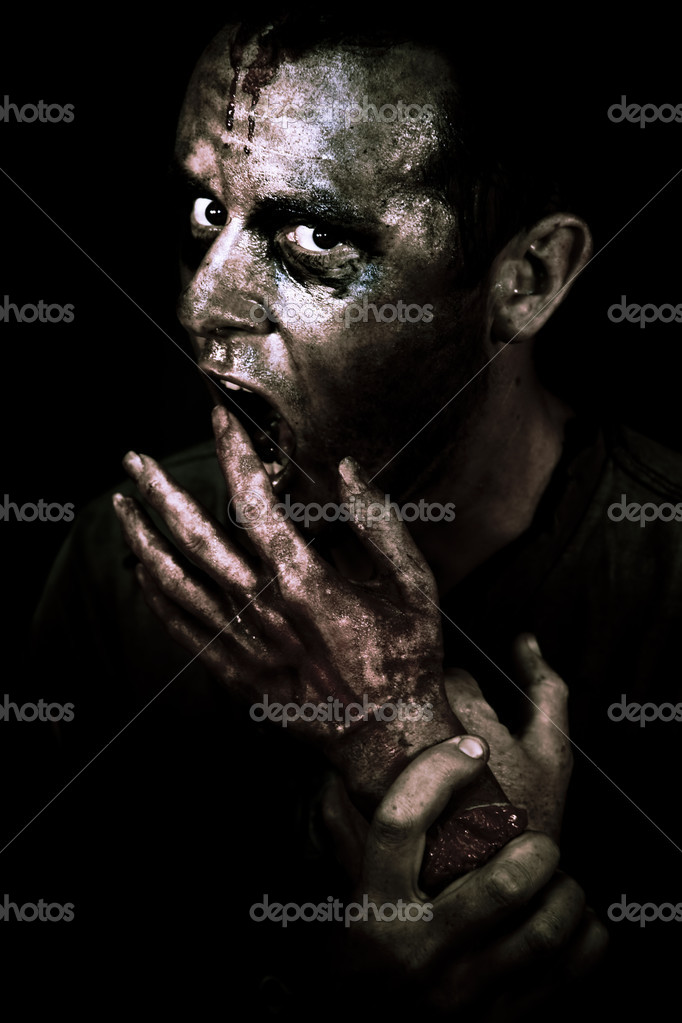 Zombie Apocalypse Concept. Dark atmospheric closeup of the face of a dirty bloodstained living dead zombie. — Stock Photo #9234142