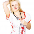 Sexy blonde nurse with stethoscope - Zdjęcie stockowe