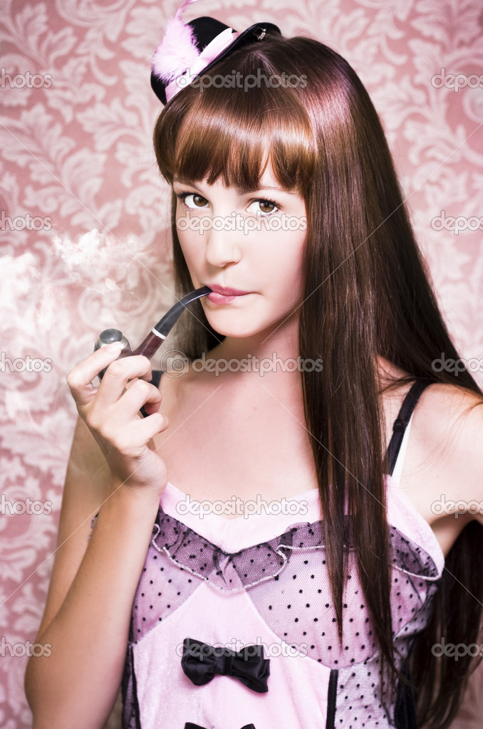 Pink Tone Photograph Of A Attractive Film Actress Smoking A Pipe Indoors Against Retro Wallpaper — Stock Photo #9726280