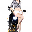 Woman leaning on a motorbike — Stock Photo