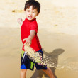 Young Asian Boy On Vacation - Stock Photo