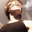 Male Glamour Model Smoking Tobaco - Stock Photo
