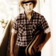 Cowboy Carrying Guitar — Stock Photo #9823565