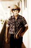 Cowboy Carrying Guitar — Stock Photo