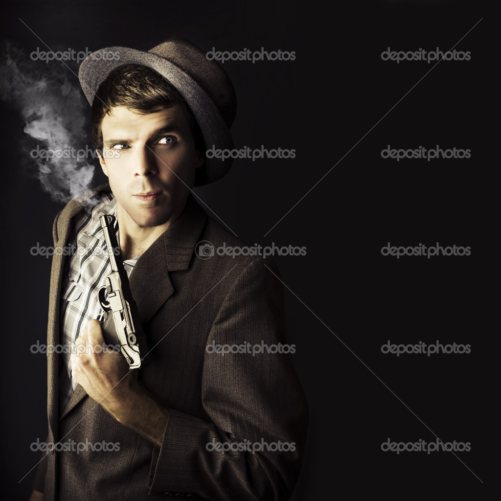 Dark Studio Image Of A Professional Hit Man Wearing Vintage Suit Holding A Retro Hand Gun In A Dangerous Business Conceptual, Isolated On Black Background — Stock Photo #9918226