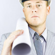 Electrical engineer carrying design blueprints - Stockfoto
