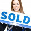 Real Estate Agent Holding Sold Sign — Stock Photo