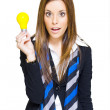 Stock Photo: Surprised Business WomWith Lightbulb Solution