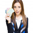Royalty-Free Stock Photo: Surprised Young Business Woman Holding Fan Of Money