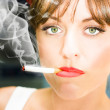 Stock Photo: Unhappy WomSmoking Cigarette