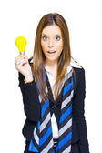 Surprised Business Woman With Lightbulb Solution — Stock Photo