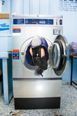 Cleaning Lady Trapped In Washing Machine — Stock Photo