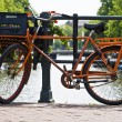 Orange bike and the canals of Amsterdam — Stock Photo #7964535