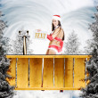 Very sexy christmas girl holding empty white board — Stock Photo