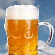 Royalty-Free Stock Photo: Big glass with beer and a background of clouds