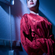 Beautiful woman in pyjama with a telephone — Stock Photo