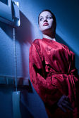 Beautiful woman in pyjama with a telephone — Stock Photo