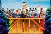 Tiroler girl in the snow behind a bar — Stock Photo
