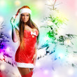 Sexy christmas girl with snow background — Stock fotografie