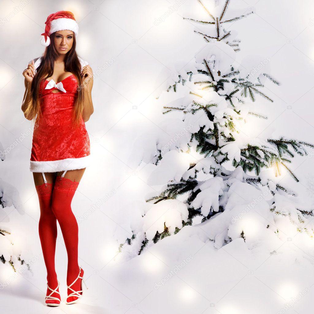 sexy weihnachts m dchen mit schnee hintergrund stockfoto. Black Bedroom Furniture Sets. Home Design Ideas