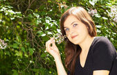 Girl and lilacs — Stock Photo