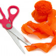Scissors and orange ribbon — Stock Photo