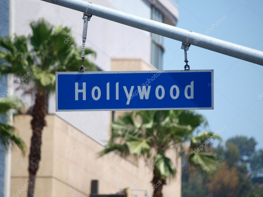 Hollywood Blvd sign with palm tree backdrop. — Stock Photo #7993397