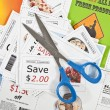 Stock Photo: Fake coupons on fake coupon background with scissors.