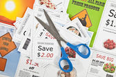Fake coupons on a fake coupon background with scissors. — Stock Photo