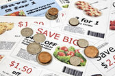 Fake Coupons with US Coins — Stock Photo