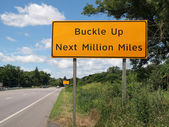 Buckle Up Sign and Highway — Stock Photo