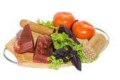 Meat and vegetables on cutting board — Stock Photo