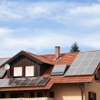 Stock Photo: Solar panels on roof of apartment house